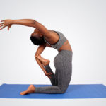 Athletic woman doing yoga kneeling on yoga mat