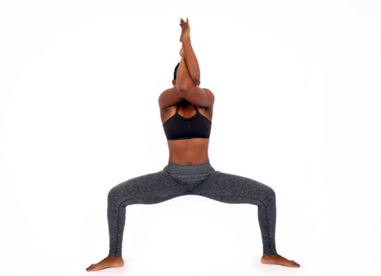 Athletic woman doing yoga pose