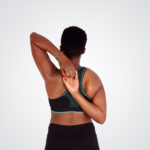 Athletic woman stretching arms and shoulder muscles