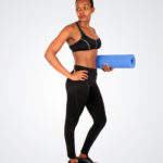 Athletic Woman With Abs Holding A Yoga Mat