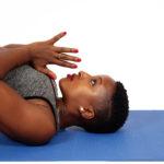 Beautiful Woman Doing Prayer Pose on Yoga Mat