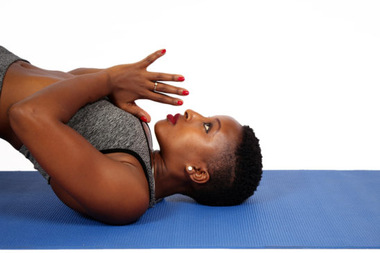 Beautiful Woman Doing Prayer Pose on Yoga Mat