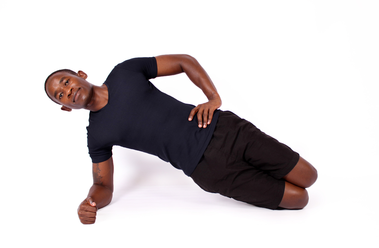 Black man doing beginner knee side plank