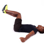 Black man doing half windshield wipers obliques exercise