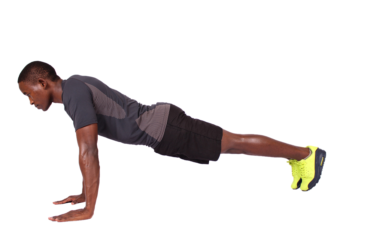 Black man doing push ups in straight arm plank position