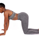 Fitness Woman Doing Cat-Cow Pose For Back Pain
