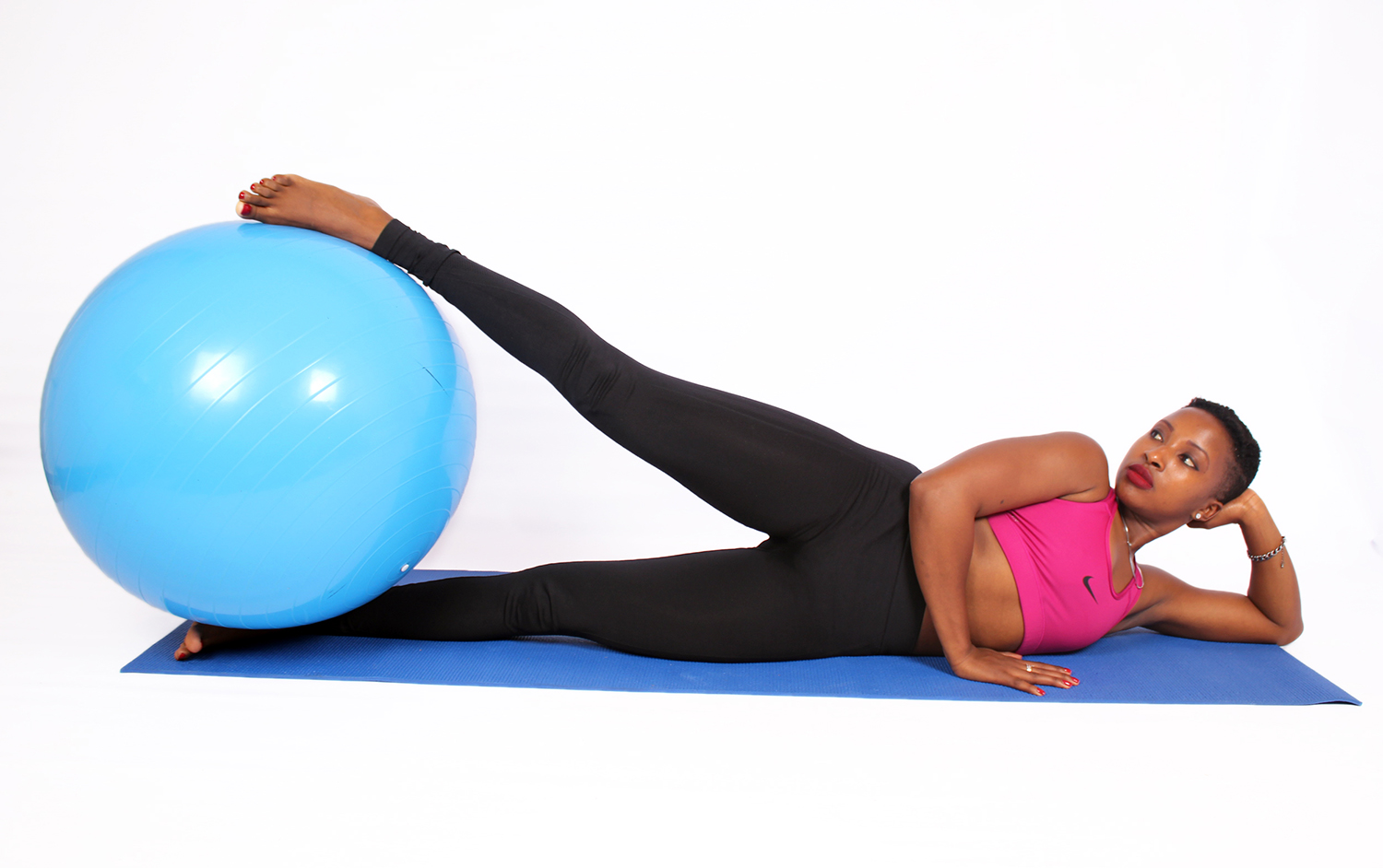 Exercising woman with swiss ball