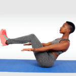 Female doing ab exercise on yoga mat