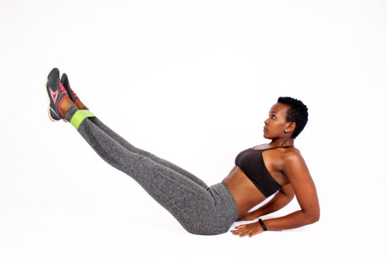 Female doing ab exercise with resistance band