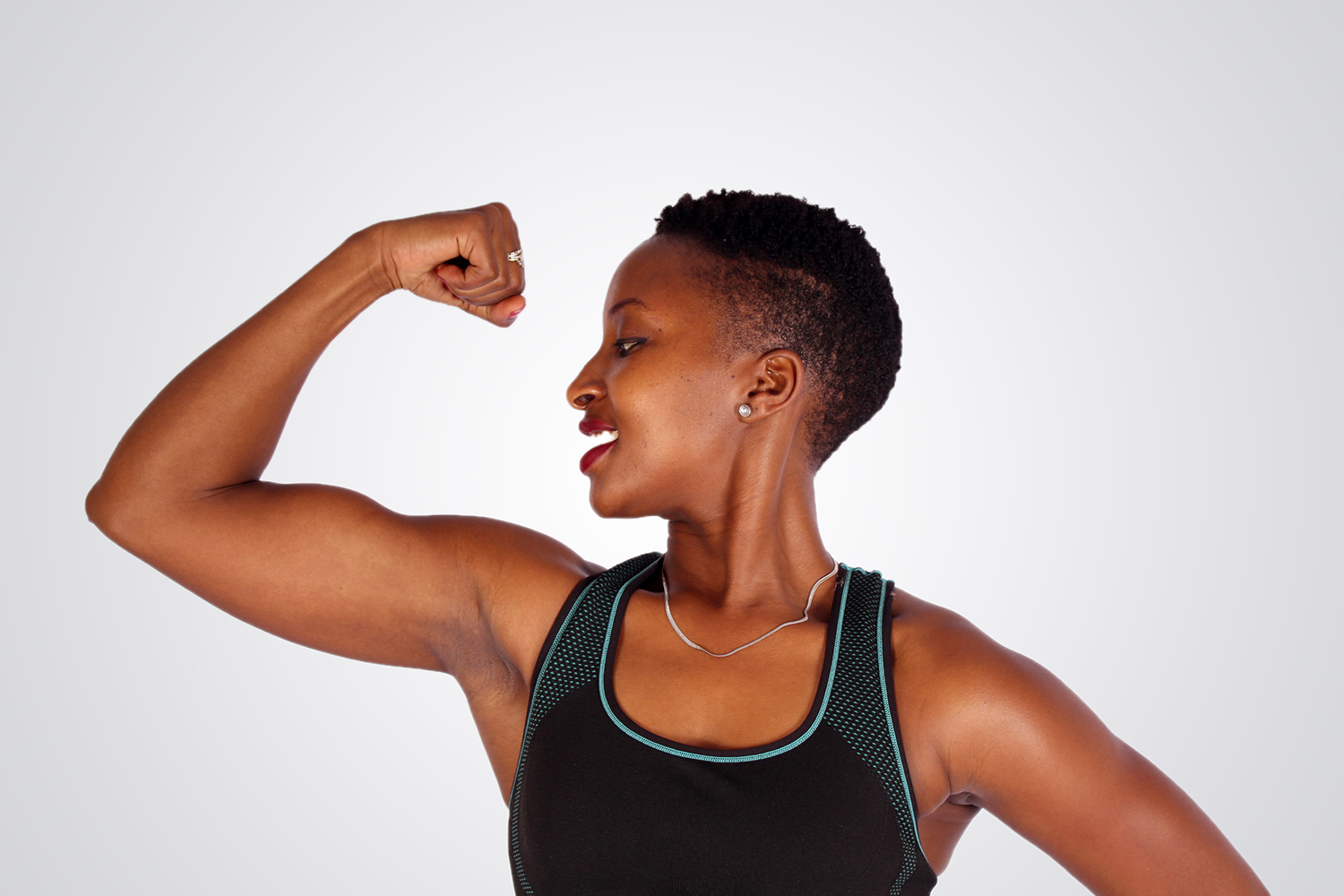 Female Trainer Flexing Biceps Muscles