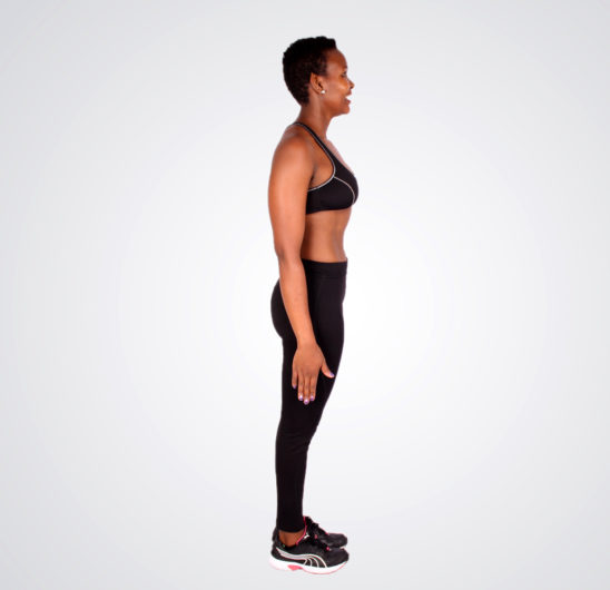 Fit african woman stand upright ready to exercise