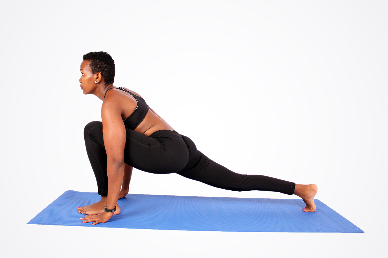 Fit Woman Doing Low Lunge Yoga Pose