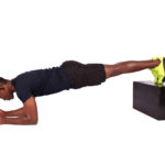 Fit athletic male doing plank with legs elevated