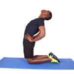 Fit athletic man stretching stomach and hip flexors kneeling