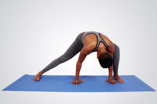 Fit athletic woman doing yoga
