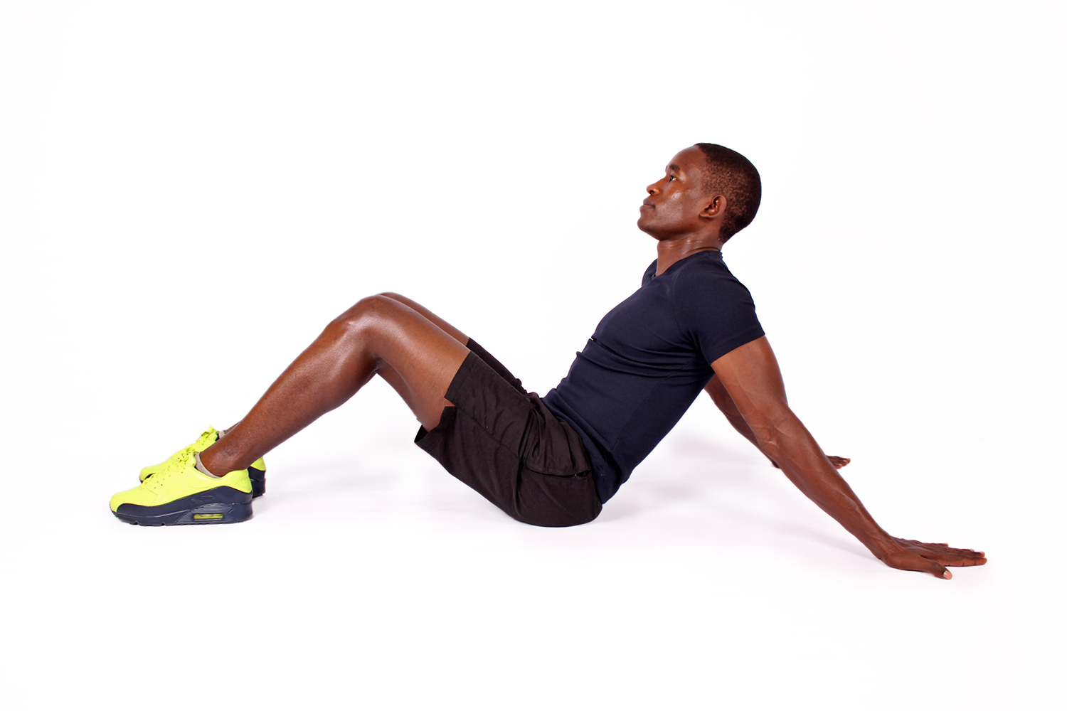 Fit athletic man sitting ready to exercise