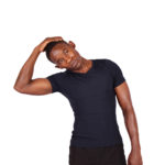 Fit black man with neck pain stretching neck muscles