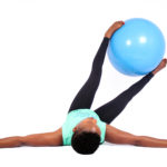 Fit female doing ab exercise using swiss ball
