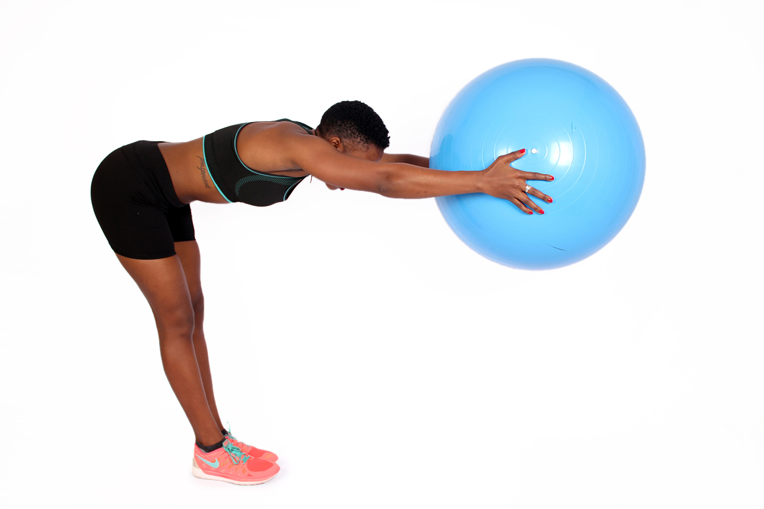 Fit female exercising with yoga swiss ball