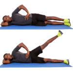 Fit man demonstrates how to do side lying leg raises