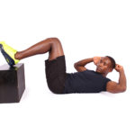 Fit man doing crunches with feet elevated