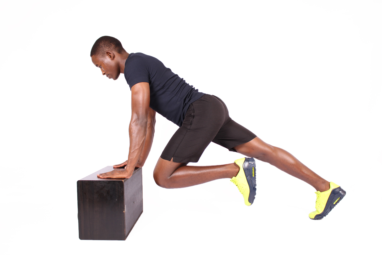 Fit man doing elevated mountain climbers exercise