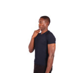 Fit man doing neck tuck to improve posture