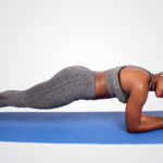 Fit woman doing front plank exercise