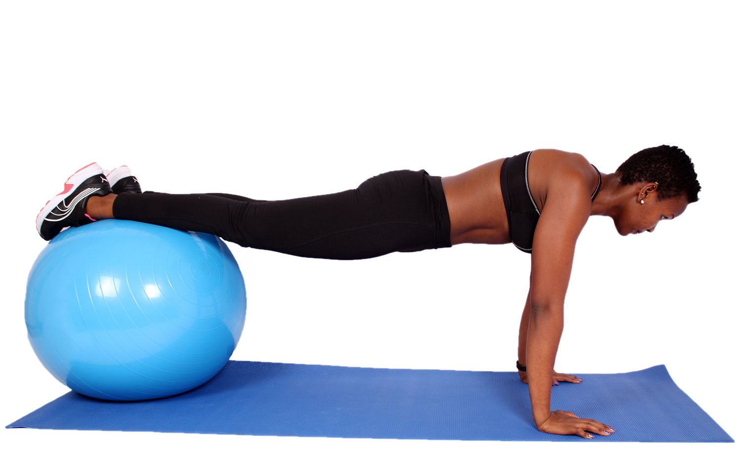 Fit woman doing push ups on swiss ball
