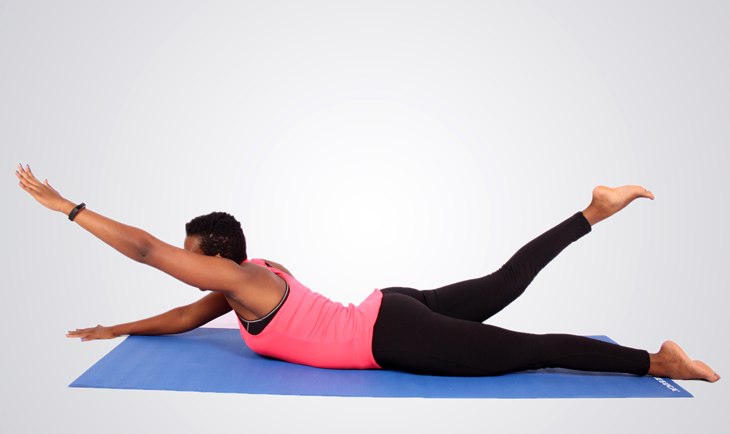 Fit woman doing swimmers core exercise