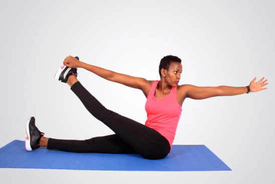 Fit woman doing yoga pose