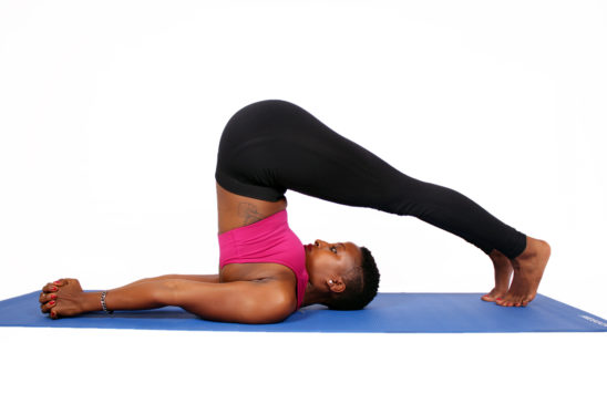 Fit woman doing yoga pose butt up