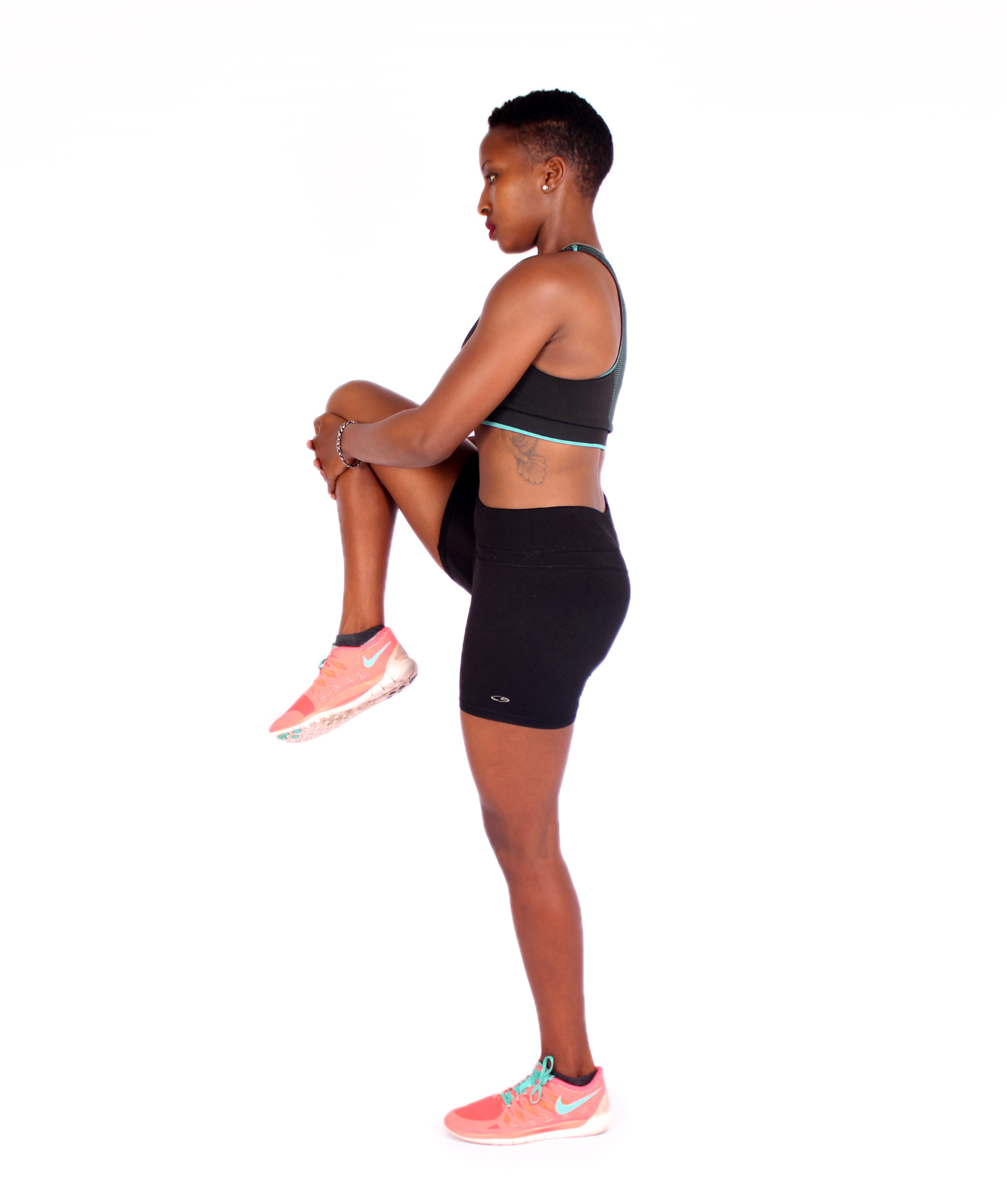 Fit woman stretching legs while standing