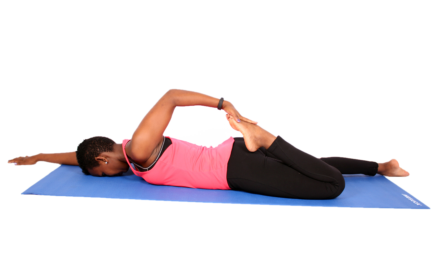 Fit woman stretching quadriceps lying face down