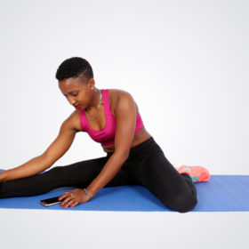 Fitiness woman stretching using the phone