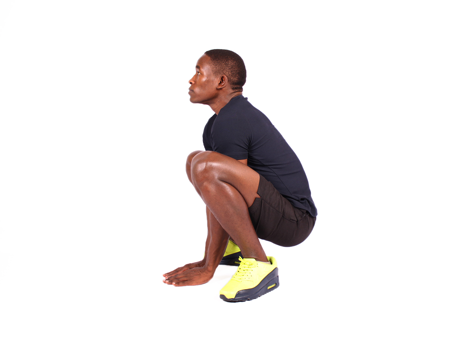 Fitness man doing deep squat exercise