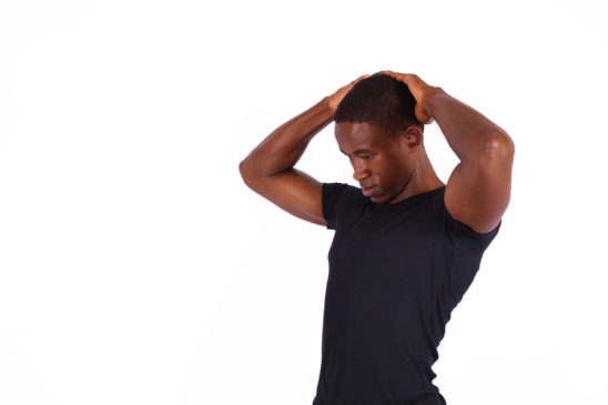 Fitness man stretch neck to relieve neck pain