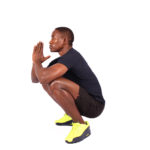 Fitness Man With Flexible Hips Doing Deep Squats