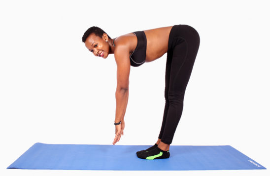 Fitness woman beding to touch toes