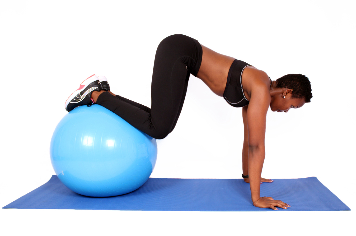 Fitness woman doing ab exercise with swiss ball