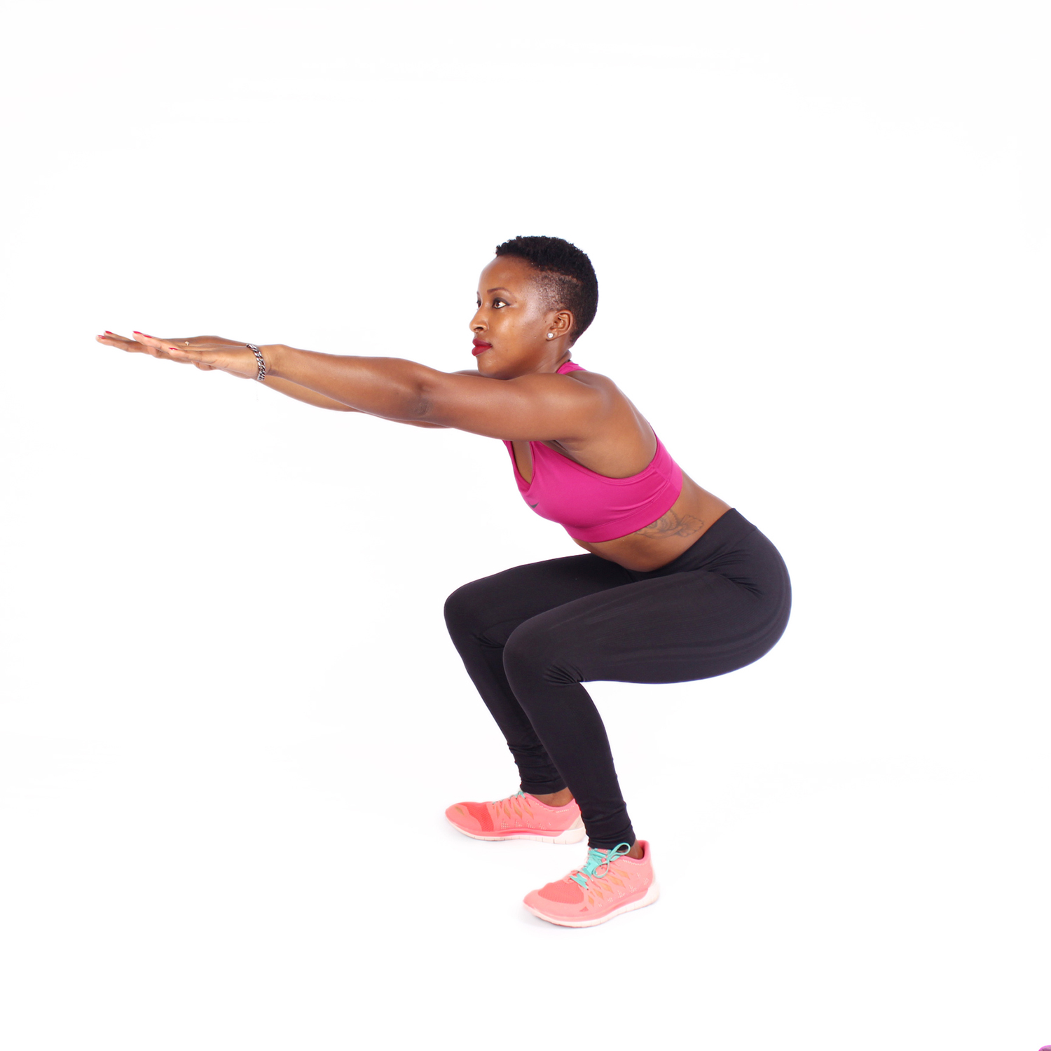 Fitness woman doing air squats white background