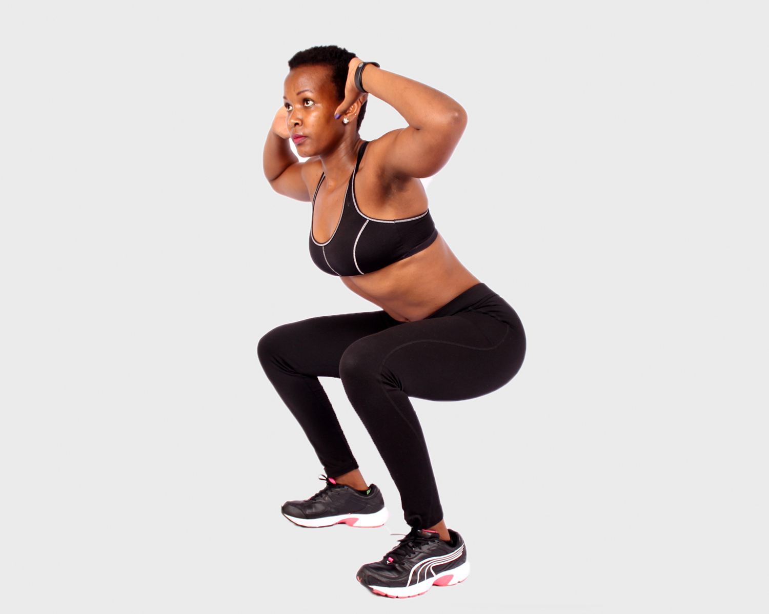 Fitness woman doing air squats