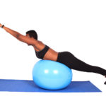 Fitness woman doing back exercise on swiss ball