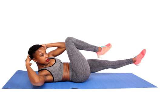Fitness woman doing bicycles ab crunches exercise