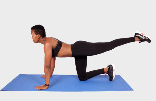 Fitness woman doing butt exercise