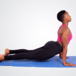 Fitness woman doing cobra yoga pose