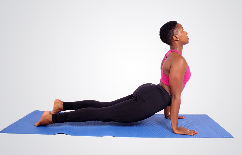 Fitness woman doing cobra yoga pose