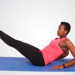 Fitness woman doing core and ab exercise