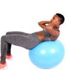 Fitness woman doing crunches on swiss ball