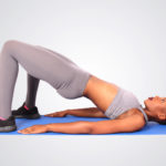 Fitness woman doing glute bridges